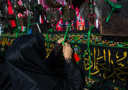 Iranian Shiite Women Putting Green Ribbons On An Alam To Make Wishes During Chehel Menbari Festival On Tasua Day, Lorestan Province, Khorramabad, Iran