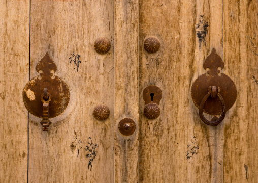 Male And Female Doorknockers On An Old Wooden Door, Fars Province, Abarkooh, Iran