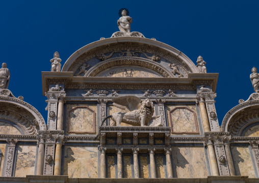 Detail of an old building with lion statue, Veneto Region, Venice, Italy