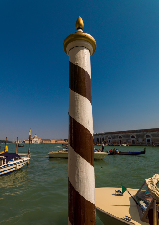 Striped wooden pole, Veneto Region, Venice, Italy