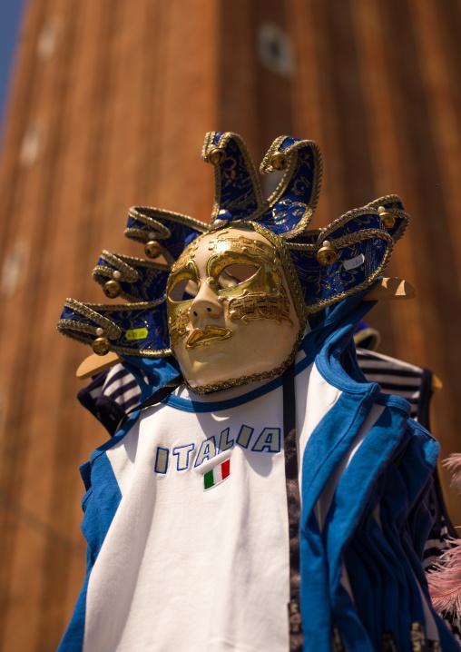 Masquerade mask abd a football shirt, Veneto Region, Venice, Italy