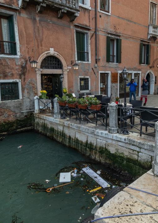 Pollution by a small canal in the old town, Veneto, Venice, Italia