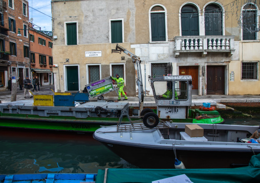 Boat collecting garbage in the canal, Veneto, Venice, Italia