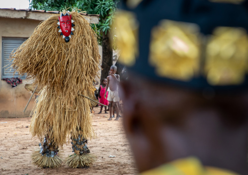 Goli mask dance in front of a tribal chief in Baule tribe, Région des Lacs, Bomizanbo, Ivory Coast