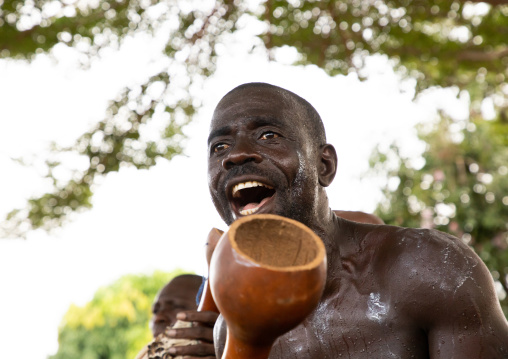 Musician performing during a Goli sacred mask dance in Baule tribe, Région des Lacs, Bomizanbo, Ivory Coast