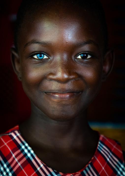 Beautiful african girl with heterochromia iridis causing two different colored eyes, Moyen-Comoé, Abengourou, Ivory Coast