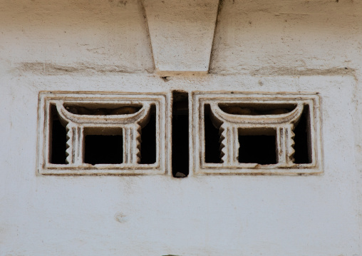 Aeration over a door with the shape of traditional seats, Sud-Comoé, Grand-Bassam, Ivory Coast