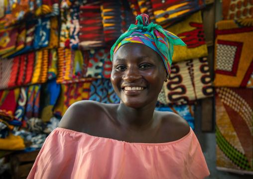 Portrait of a smiling african woman inside a shop, Sud-Comoé, Grand-Bassam, Ivory Coast