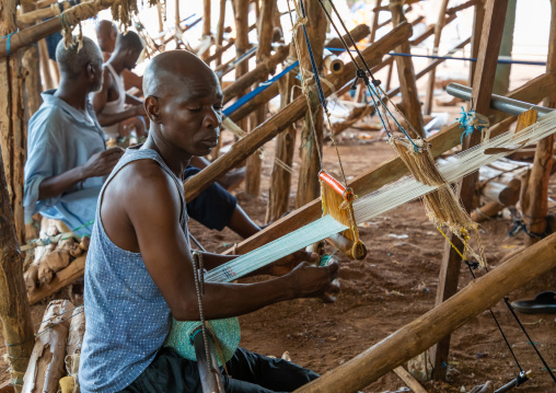 African men weaving in a traditional textile factory, Savanes district, Waraniene, Ivory Coast