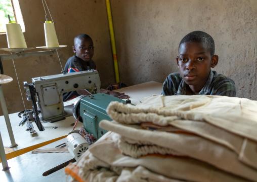 Young Senufo children working with sewing machines in a workshop, Savanes district, Waraniene, Ivory Coast
