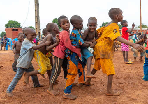 African children dancing in line during the Boloye dance of the panther man, Savanes district, Waraniene, Ivory Coast