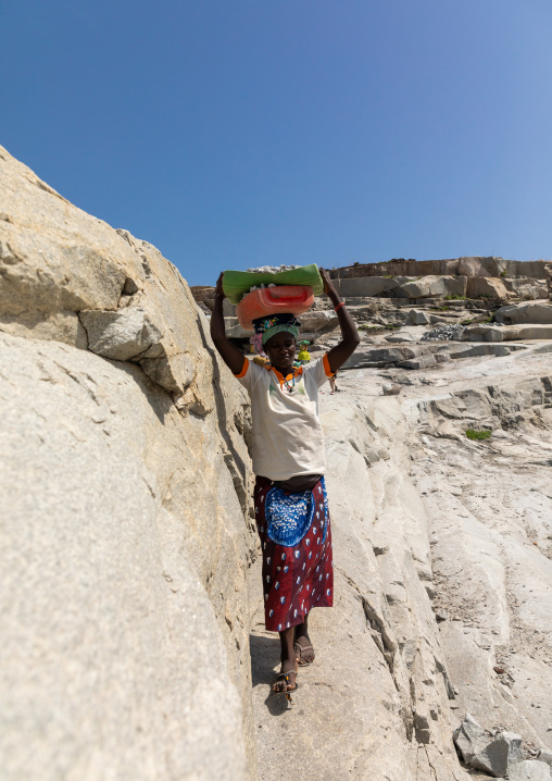 African women carrying stones in a granite quarry, Savanes district, Shienlow, Ivory Coast