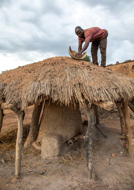 Senufo blacksmith putting charcoal from the top of the house, Poro region, Koni, Ivory Coast
