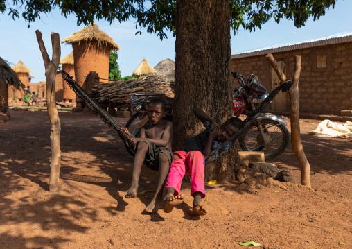 Senufo children resting on a hammock in a village, Savanes district, Niofoin, Ivory Coast