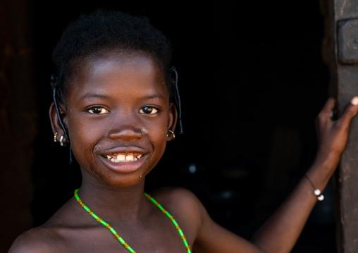 Portrait of a smiling Senufo girl, Savanes district, Niofoin, Ivory Coast