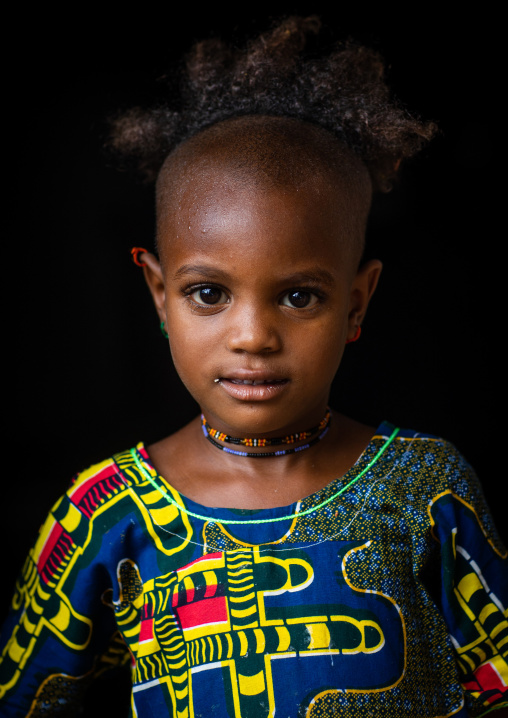 Portrait of a Peul tribe girl with a strange haircut, Savanes district, Boundiali, Ivory Coast