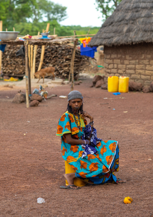 Peul tribe girls sit in the middle of a village, Savanes district, Boundiali, Ivory Coast