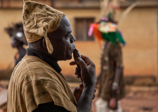 Senufo man using a flute during the Ngoro dance, Savanes district, Ndara, Ivory Coast