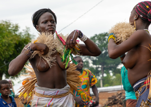 Young Senufo shirtless women dancing the Ngoro during a ceremony, Savanes district, Ndara, Ivory Coast