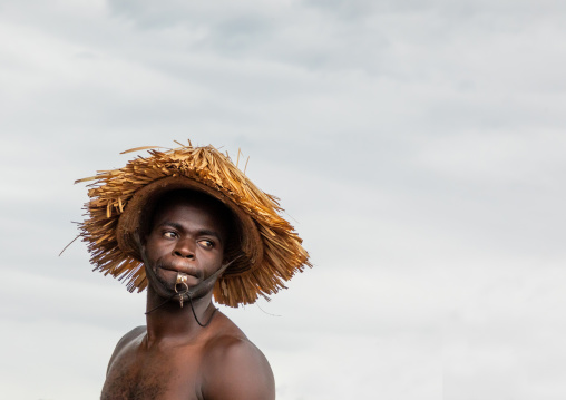 Senufo shirtless man dancing the Ngoro during a ceremony, Savanes district, Ndara, Ivory Coast