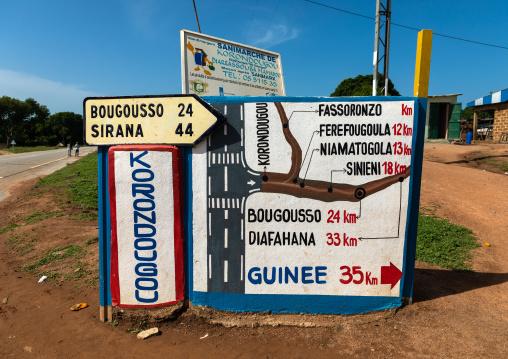 Arrows and signposts on the road, Denguélé, Korondougou, Ivory Coast
