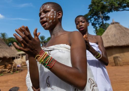 Dan tribe young women clapping hands and dancing during a ceremony, Bafing, Gboni, Ivory Coast