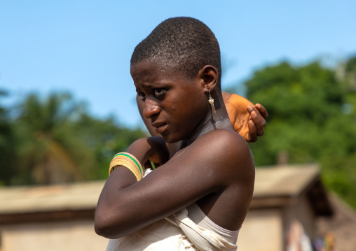 Dan tribe young woman dancing during a ceremony, Bafing, Gboni, Ivory Coast