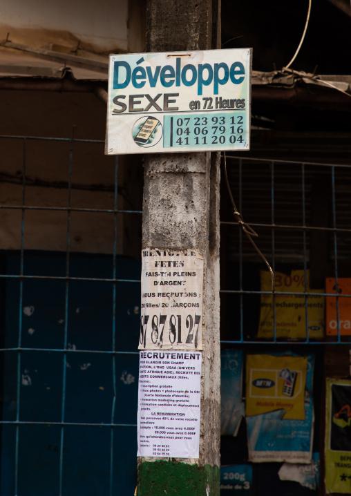 Advertisement in the street for erectile dysfunction, Tonkpi Region, Man, Ivory Coast