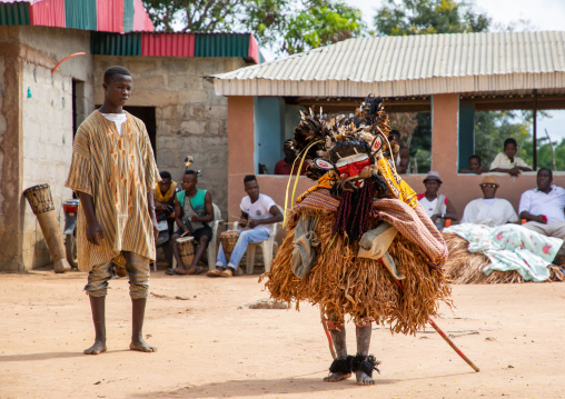 We Guere sacred mask dance in front of the village leaders during a ceremony, Guémon, Bangolo, Ivory Coast