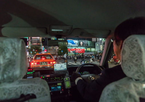 A taxi driver inside his car at night in shibuya, Kanto region, Tokyo, Japan