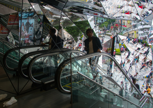 Walking people reflected on glass in tokyu plaza i, Kanto region, Tokyo, Japan