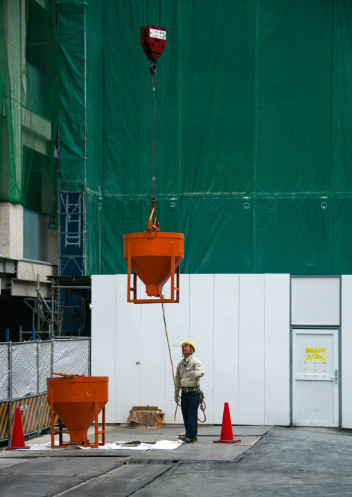 Worker in a building construction site, Kanto region, Tokyo, Japan