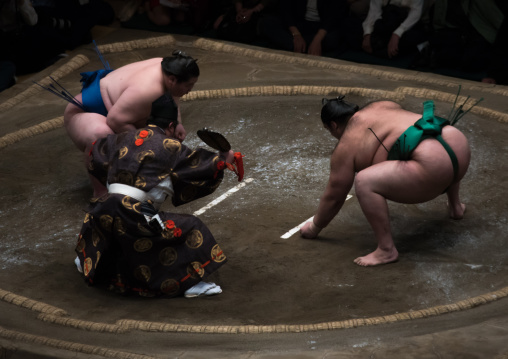 Two sumo wrestlers fighting at the ryogoku kokugikan arena, Kanto region, Tokyo, Japan