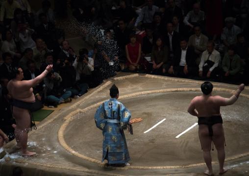 Sumo wrestlers before the fight in the ryogoku kokugikan sumo arena, Kanto region, Tokyo, Japan