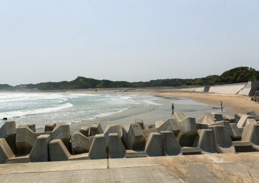 Japanese surfers in the contaminated area after the daiichi nuclear power plant irradiation, Fukushima prefecture, Tairatoyoma beach, Japan