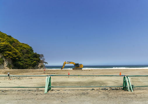 Caterpillar removing sand on a contaminated beach after the daiichi nuclear power plant irradiation, Fukushima prefecture, Tairatoyoma beach, Japan