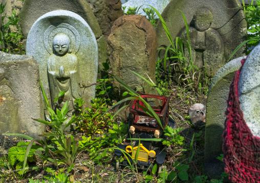 Stone baby statues called jizobosatsu protecting the souls of aborted children after the tsunami, Fukushima prefecture, Tairatoyoma beach, Japan
