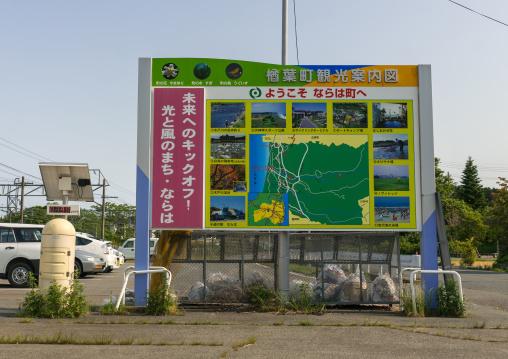 A radiation dosimeter placed in a highly contaminated area near a tourist map, Fukushima prefecture, Naraha, Japan