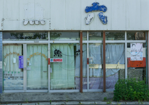 Abandoned restaurant with a no yakusa entry sign in the highly contaminated area after the daiichi nuclear power plant irradiation, Fukushima prefecture, Naraha, Japan