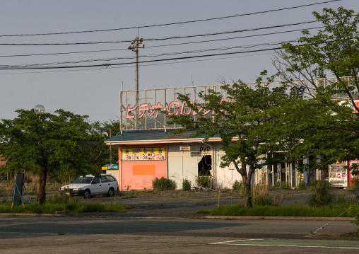 Abandoned shop in the difficult-to-return zone after the daiichi nuclear power plant irradiation, Fukushima prefecture, Tomioka, Japan