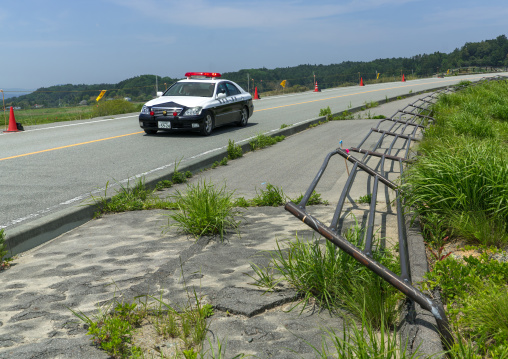 Police car patroling in the highly contaminated area after the daiichi nuclear power plant irradiation, Fukushima prefecture, Futaba, Japan