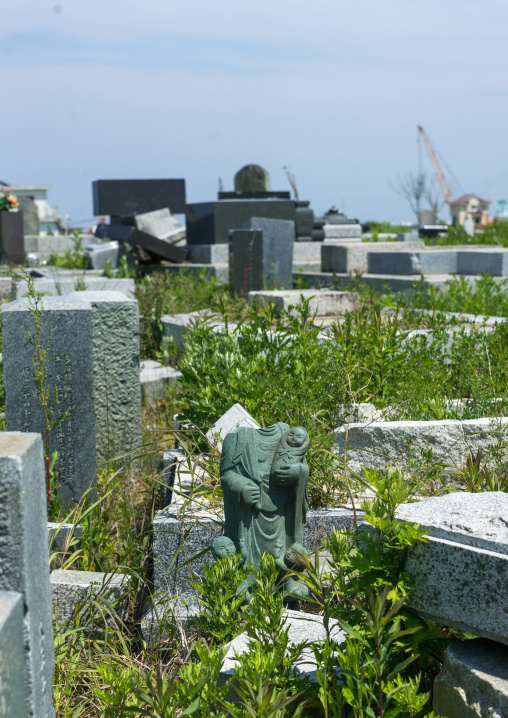 The remains of a destroyed cemetery after the 2011 earthquake and tsunami, Fukushima prefecture, Namie, Japan