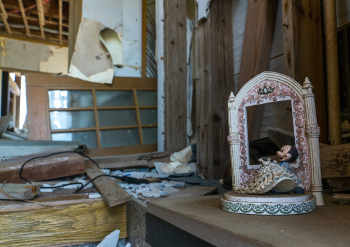 Mickey mouse toy inside a house destroyed by the 2011 earthquake and tsunami five years after, Fukushima prefecture, Namie, Japan