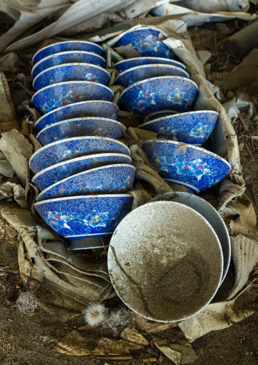 Blue bowls inside a house destroyed by the 2011 earthquake and tsunami five years after, Fukushima prefecture, Namie, Japan