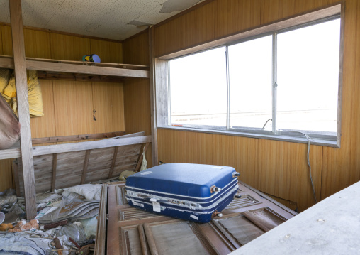 A suitcase inside a house destroyed by the 2011 earthquake and tsunami five years after, Fukushima prefecture, Namie, Japan