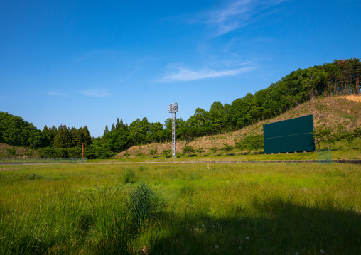 Baseball field in the highly contaminated area after the daiichi nuclear power plant explosion, Fukushima prefecture, Iitate, Japan