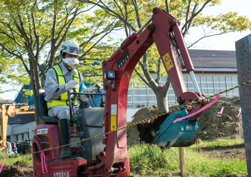 Decontamination work no entry sign in front of workers who remove top soil contaminated by nuclear radiations after the daiichi nuclear power plant explosion, Fukushima prefecture, Iitate, Ja