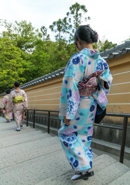 Chinese tourist women wearing geisha kimonos, Kansai region, Kyoto, Japan