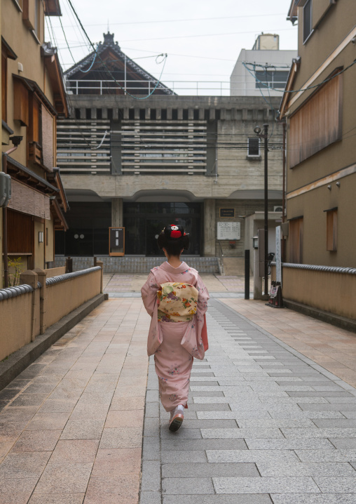 16 Years old maiko called chikasaya walking in the streets of gion, Kansai region, Kyoto, Japan
