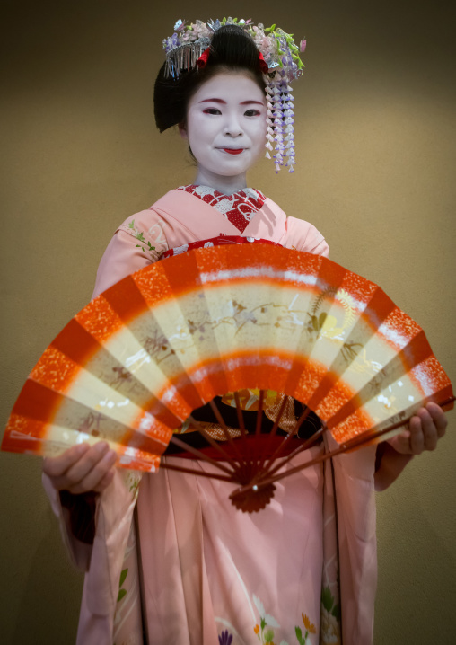 16 Years old maiko called chikasaya dancing with a fan, Kansai region, Kyoto, Japan